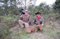 Jim Shockey+Cameraman Matt with Jims SCI World Record For Archery Hog Deer 2014